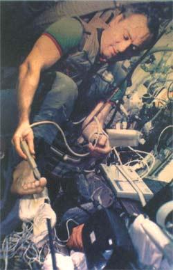 Valeri Polyakov using the Prognos system aboard of the Mir